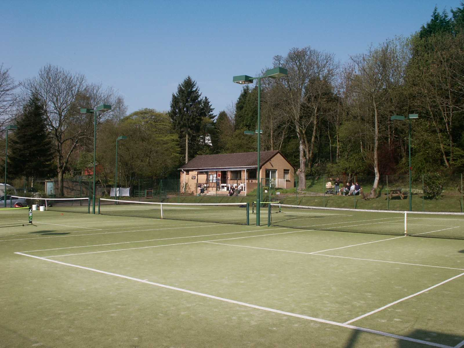 Courts and clubhouse on a sunny day....